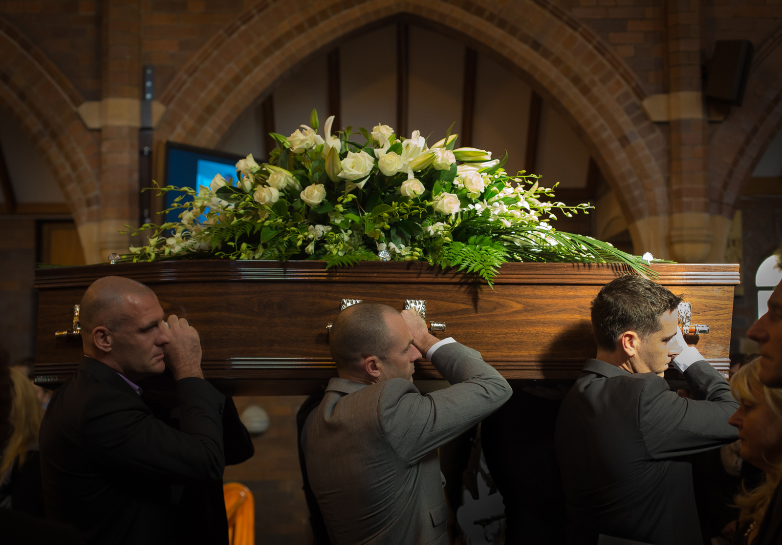 Grief - my brother's coffin is carried from the church